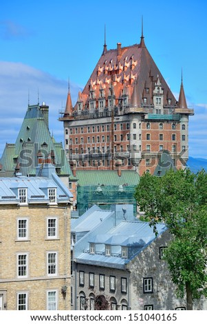 Chateau Frontenac in the day with cloud and blue sky in Quebec City with roof - stock photo