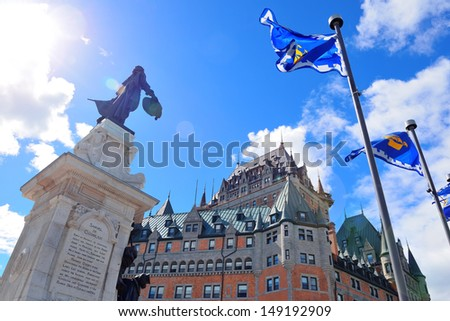 Chateau Frontenac in the day with cloud and blue sky in Quebec City with statue - stock photo