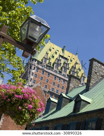 Chateau Frontenac, located in Quebec City, sits majestically over the St. Lawrence Seaway in Canada. - stock photo