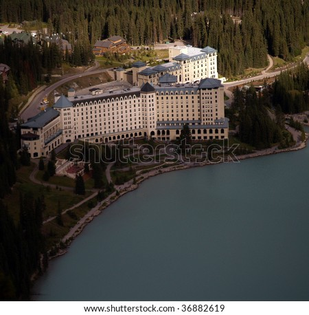 "Chateau Lake Louise viewed from the ""Big Beehive"" lookout on one of the mountains to the north of the lake - stock photo"