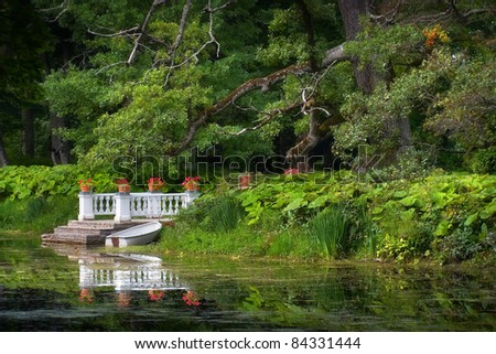 Chateau Park with Boat in Summer - stock photo