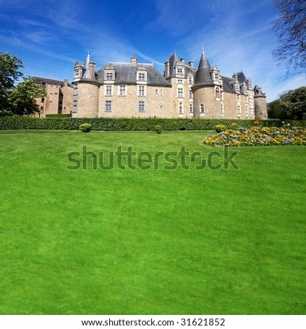 Chateaubriant Chateau and park land with copy space - stock photo