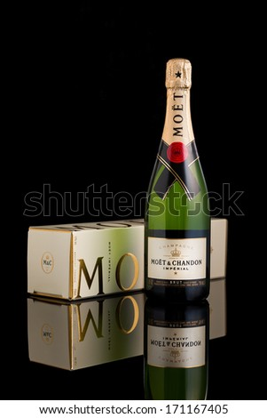 CHATHAM, NJ - JANUARY 13, 2014: Bottle of Moet & Chandon champagne. Moet Chandon is one of the world's largest champagne producers co-owner of the luxury goods company Moet-Hennessy - Louis Vuitton - stock photo