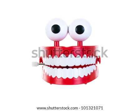 Chattering teeth on a pure white background - stock photo