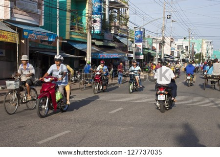 CHAU DOC, VIETNAM - JULY 23: Road Traffic on July 23, 2012 in Chau Doc, Vietnam. It is a town in the Mekong Delta region of Vietnam with a population of 112,155. - stock photo