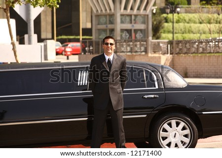 Chauffeur and Limo - stock photo