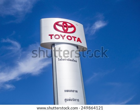 CHEANGMAI, THAILAND - JANUARY 15, 2015: TOYOTA logo installed outdoor to indicate the sale and service center. TOYOTA is Japanese's car manufacturer which sold around the world. - stock photo