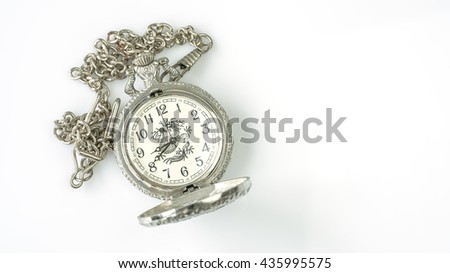 Cheap old stainless pocket watch with dragon printed on white background - stock photo