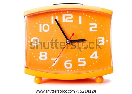 Cheap quartz alarm clock isolated on the white background - stock photo