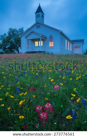 CHEAPSIDE, TEXAS - APRIL 2015 - A small church in Gonzales County, Texas is surrounded by wildflowers on the evening of April 11, 2015 - stock photo