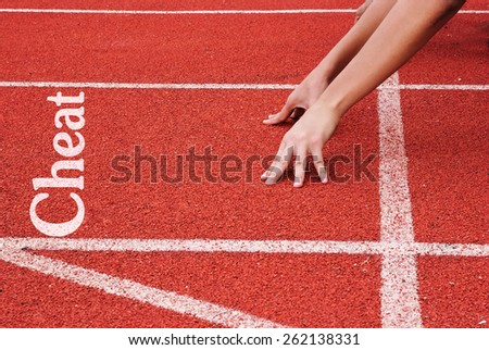 cheat - hands on starting line - stock photo