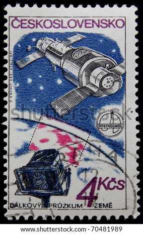 CHECH - CIRCA 1980s: A post stamp printed in Chechoslovakia shows taking photo of the Earth, series honoring Intercosmos program, circa 1980s