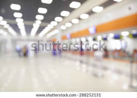 Check-in counters in airport - Defocused background - stock photo