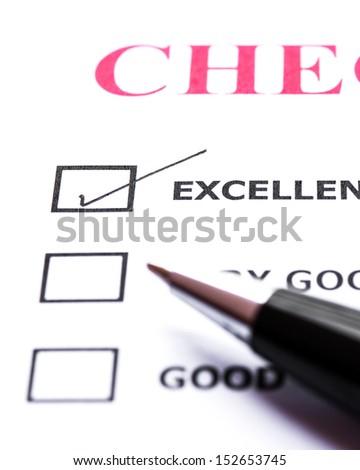 Check list with a ticked box and pen - stock photo