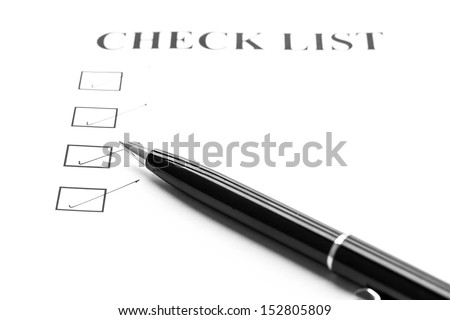 check list with a ticked box with black pen
