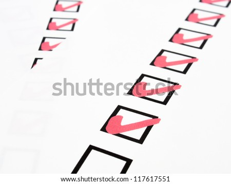 Check list with red pen marking - stock photo