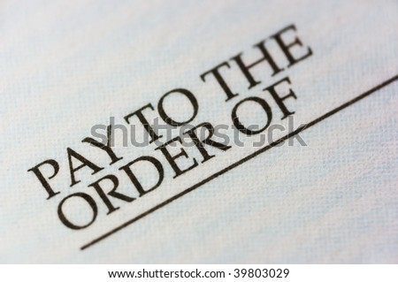 Check macro, pay to the order of.  Limited depth of field. - stock photo