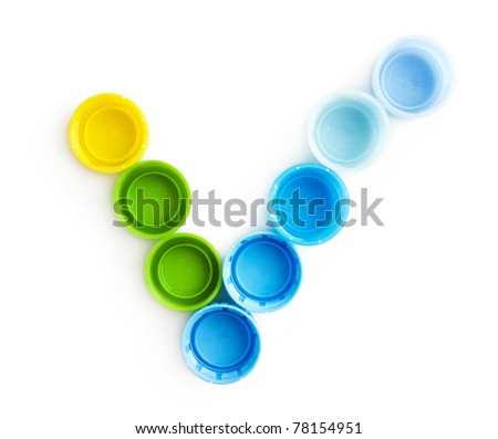 Check mark from the caps of the bottles isolated on white background - stock photo