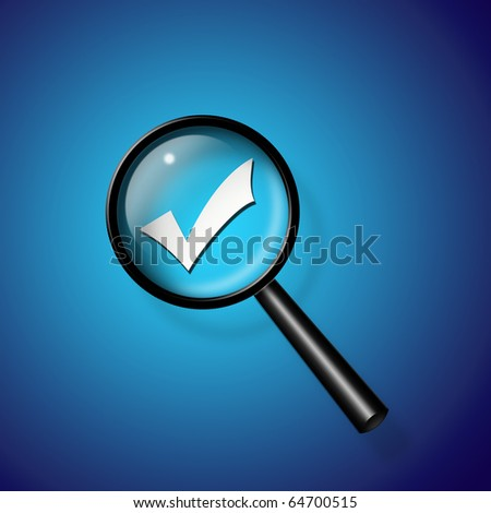 Check Mark under magnify glass - stock photo