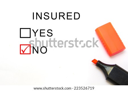Check mark with red marker on No Insured - stock photo