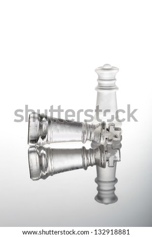 Check mate chess glass pieces - stock photo