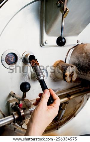check of coffe roasting process - stock photo