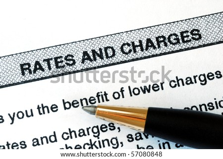 Check out the rates and charges from a bank statement - stock photo