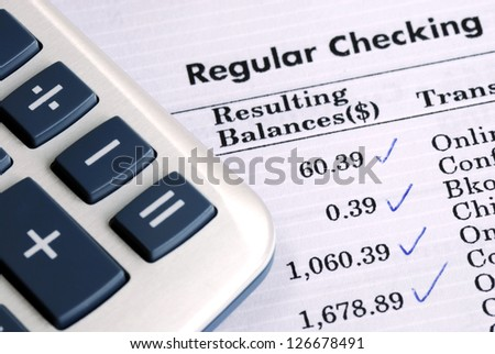 Check the bank statement and balance the account - stock photo