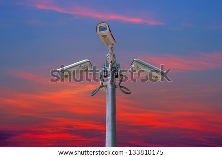 Check the movement of the traffic cameras. The evening sky as a backdrop. - stock photo