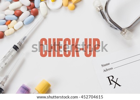 CHECK-UP written on white background with medication - stock photo