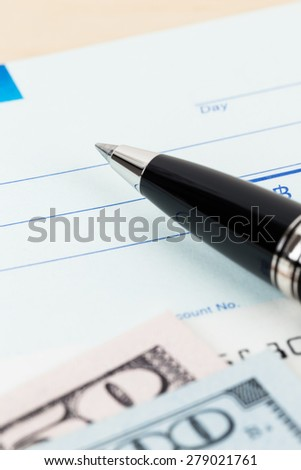 Check with pen and banknote - stock photo