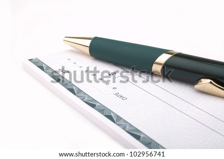 Checkbook and pen - stock photo
