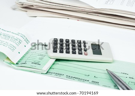 Checkbook, pen and calculator isolated on white background - stock photo