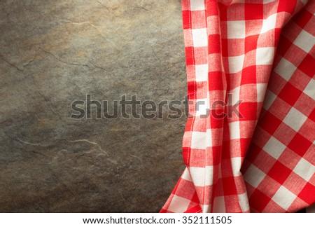 checked cloth napkin at table - stock photo