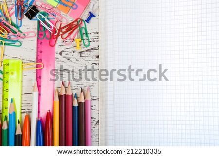checked note paper with a pencil and paper clips - stock photo