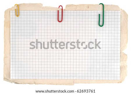 Checked notebook paper on the old grungy cardboard background - stock photo