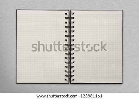 checked notepad on metal background - stock photo