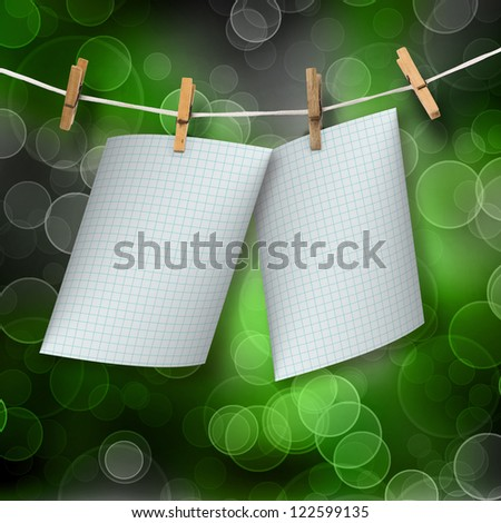 Checked sheets hanging on a rope and clothespins on the abstract blur boke background - stock photo