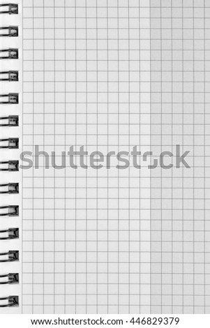 Checked spiral notebook background pattern, vertical chequered squared open notepad copy space, stapled blank empty blocknote, reminder concept metaphor, large detailed macro closeup - stock photo