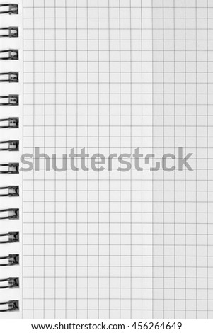 Checked spiral notebook background pattern, vertical chequered squared open notepad copy space, stapled blank empty blocknote, reminder concept metaphor, large detailed macro closeup
