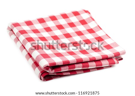 Checked with red and white tablecloth isolated over white background - stock photo