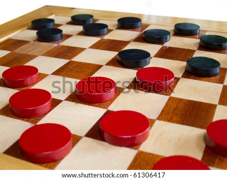 checker board with checkers isolated on background - stock photo