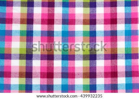 Checkered background of colored cotton fabric - stock photo