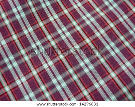 Checkered fabric closeup. Series - red & blue. Good for background. More fabrics in my port. - stock photo