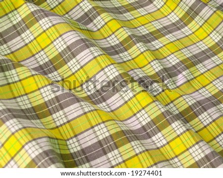 Checkered fabric closeup. Yellow. More fabrics in my port.  - stock photo