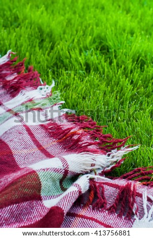 Checkered Plaid Picnic Green Grass Summer Time Background Freedom Concept - stock photo