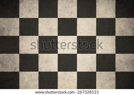 Checkered race flag on concrete textured background - stock photo