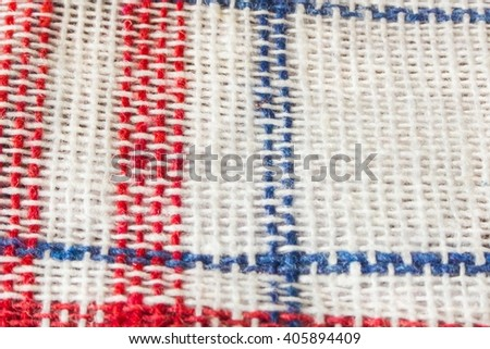 Checkered red fabric close up view as background or texture - stock photo