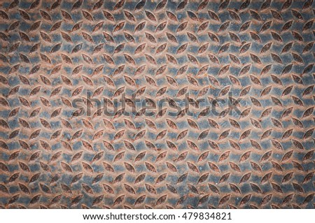 Checkered steel plate with rusty background