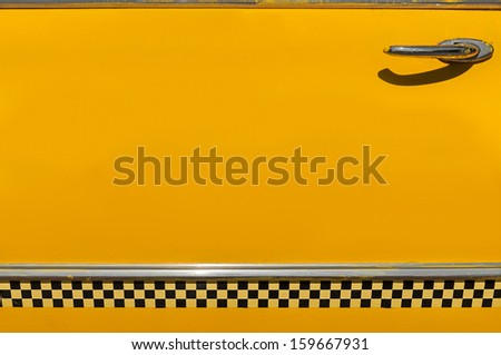 Checkered Yellow Taxi Cab Door - add your own copy - stock photo